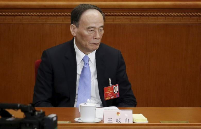 China's Politburo Standing Committee member Wang Qishan, the head of China's anti-corruption watchdog, pauses during the opening session of the National People's Congress (NPC) in Beijing, China, March 5, 2016. REUTERS/Jason Lee