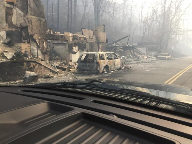 Burned buildings and cars aftermath of wildfire is seen in this image released in social media by Tennessee Highway Patrol in Gatlinburg, Tennessee, U.S. on November 29, 2016. Courtesy Tennessee Highway Patrol/Handout via REUTERS