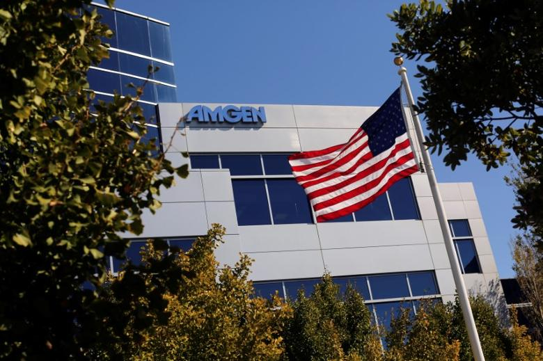An Amgen sign is seen at the company's office in South San Francisco, California October 21, 2013. REUTERS/Robert Galbraith/File Photo