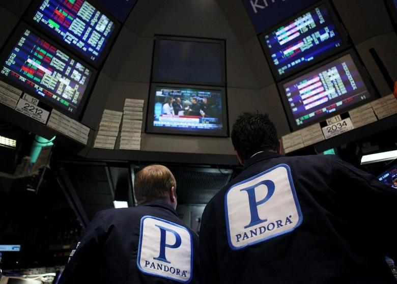 Traders work at the kiosk where Pandora internet radio is traded on the floor of the New York Stock Exchange, in this June 15, 2011 file photo.   REUTERS/Brendan McDermid/File Photo