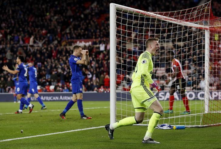 Britain Football Soccer - Sunderland v Leicester City - Premier League - The Stadium of Light - 3/12/16 Sunderland's Jordan Pickford celebrates after making a save as Leicester City players look on dejected   Action Images via Reuters / Lee Smith Livepic