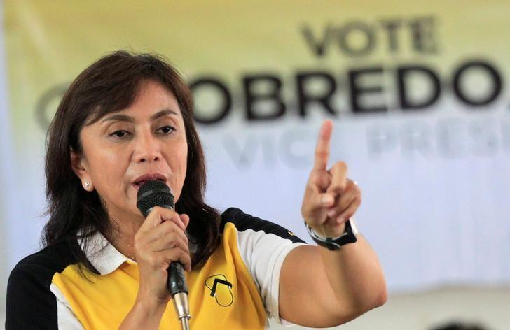 Leni Robredo gestures as she talks to her supporters during a campaign rally in Quezon City, Metro Manila, Philippines May 4, 2016.  REUTERS/Romeo Ranoco/Files