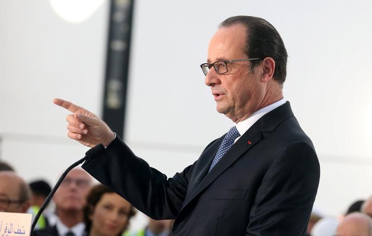France's President Francois Hollande gestures as he speaks during a visit to Louvre Abu Dhabi, in Abu Dhabi, United Arab Emirates, December 3, 2016. REUTERS/Stringer