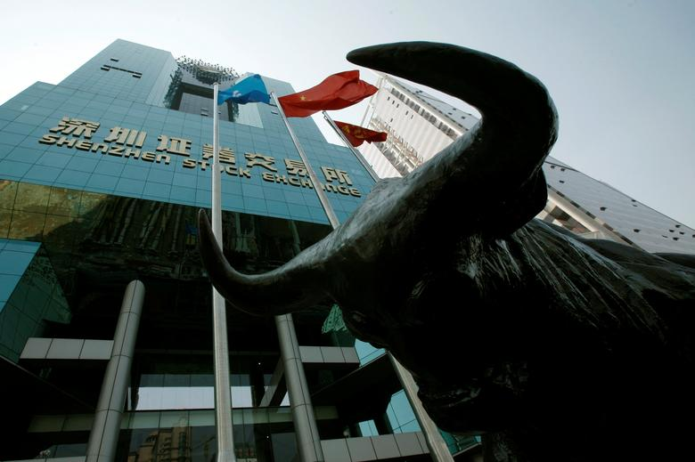 A statue of a bull is displayed outside the Shenzhen Stock Exchange in the southern Chinese city of Shenzhen October 23, 2009. REUTERS/Bobby Yip/File Photo