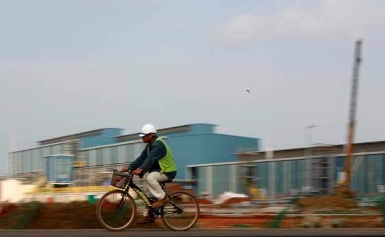 A worker rides his bicycle inside the Lynas factory in Gebeng, 270 km (168 miles) east of Kuala Lumpur April 19, 2012.  REUTERS/Samsul Said/File Photo