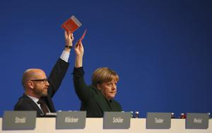 German Chancellor and leader of the conservative CDU Merkel and Tauber vote...