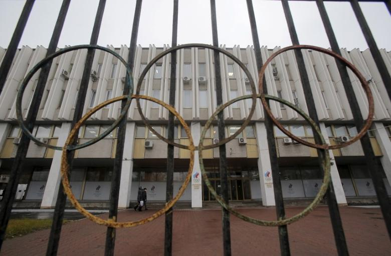 A view through a fence shows the Russian Olympic Committee headquarters, which also houses the management of Russian Athletics Federation in Moscow, Russia, November 10, 2015. The Russian Sports Ministry said on Tuesday it was open for closer cooperation with the World Anti-Doping Agency (WADA) in order to eliminate any irregularities committed by the Russian anti-doping watchdog and its accredited laboratory. WADA has recommended that Russian athletes are excluded from international events including the 2016 Olympic Games in Brazil. REUTERS/Maxim Shemetov       TPX IMAGES OF THE DAY      - RTS697U