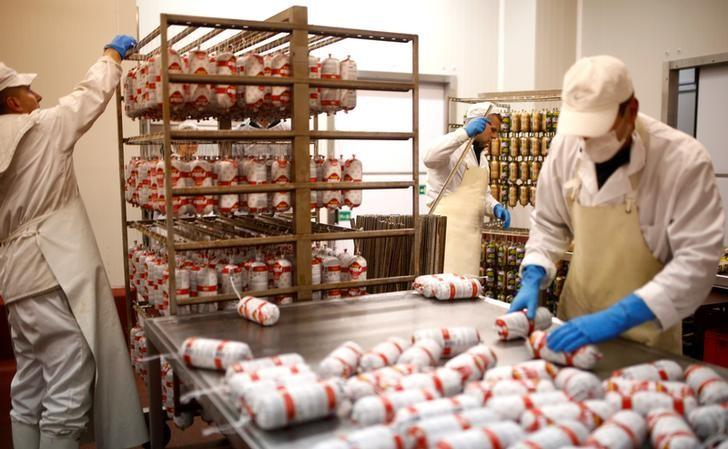 Workers work in salami production section in Akova Impex Meat Industry Ovako, which makes halal quality certified products, in Sarajevo, Bosnia and Herzegovina, December 2, 2016. Picture taken December 2. REUTERS/Dado Ruvic