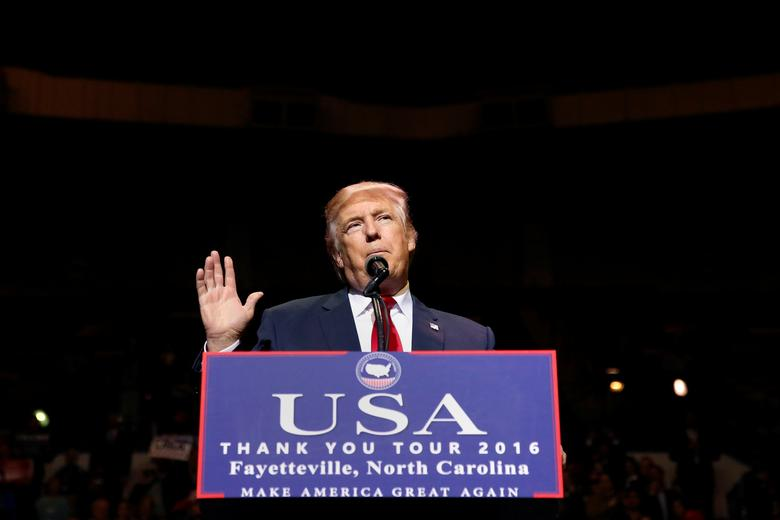 U.S. President-elect Donald Trump speaks at a USA Thank You Tour event at Crown Coliseum in Fayetteville, North Carolina, U.S., December 6, 2016. REUTERS/Shannon Stapleton