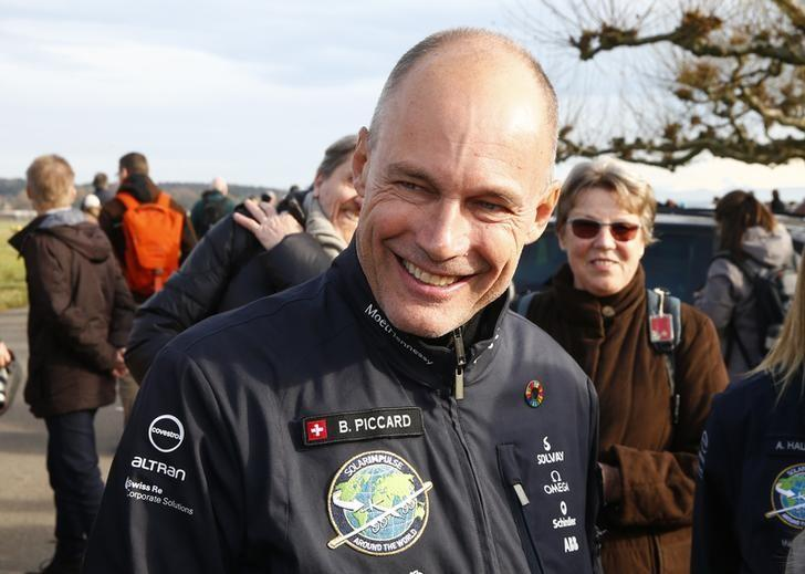 Swiss aviator Bertrand Piccard speaks with guests before the arrival of the Solar Impulse 2 aircraft for its return to where it was built in Duebendorf near Zurich, Switzerland, November 22, 2016. REUTERS/Arnd Wiegmann/Files