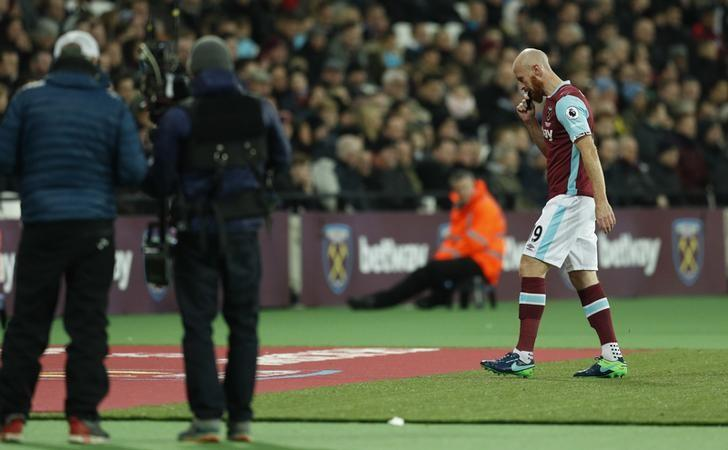 Britain Football Soccer - West Ham United v Arsenal - Premier League - London Stadium - 3/12/16 West Ham United's James Collins walks off dejected to be substituted after sustaining an injury Action Images via Reuters / John Sibley Livepic/Files