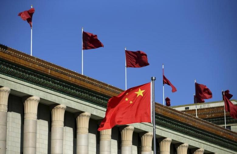 Chinese flag waves in front of the Great Hall of the People in Beijing, China, October 29, 2015. REUTERS/Jason Lee