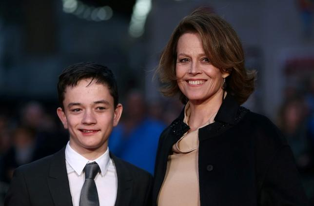 Sigourney Weaver poses with co-star Lewis MacDougall as she arrives for the gala screening of the film ''A Monster Calls'', on the second night of the 60th British Film Institute (BFI) London Film Festival at Leicester Square in London, Britain October 6, 2016.   REUTERS/Neil Hall