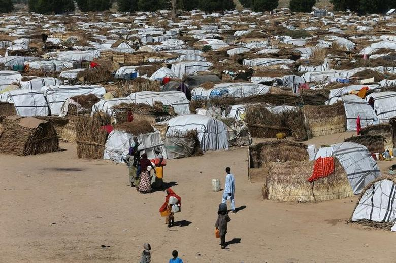 Some people seen moving within their thatched houses at the Muna Internally displace peoples camp in Maiduguri, Nigeria December 01, 2016 REUTERS/Afolabi Sotunde