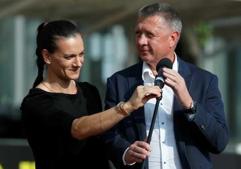 Head of the Russian Athletics Federation (ARAF) Dmitry Shlyakhtin and Olympic pole vault champion Yelena Isinbayeva arrive to deliver a speech.  Brothers Znamensky Olympic Centre, Moscow, Russia, 28/7/16. REUTERS/Maxim Shemetov