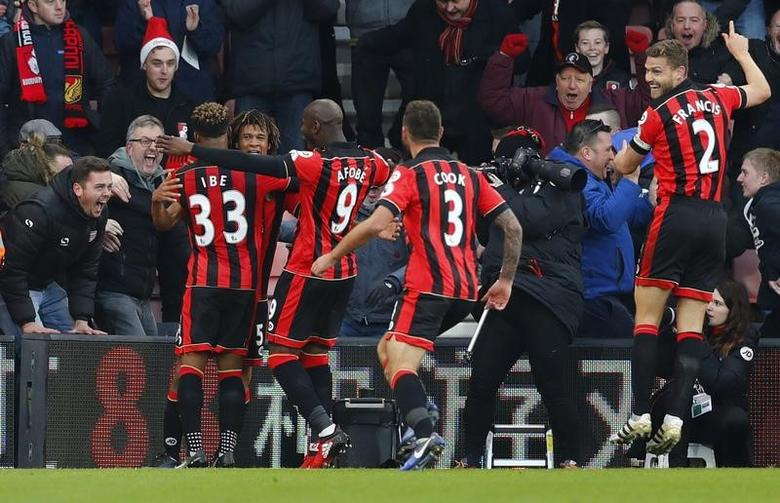 Bournemouth's Nathan Ake celebrates scoring their fourth goal with teammates. AFC Bournemouth v Liverpool - Premier League - Vitality Stadium - 4/12/16.  Reuters / Eddie Keogh Livepic
