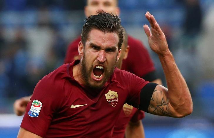 Football - Soccer - Lazio v AS Roma - Italian Serie A - Olympic Stadium, Rome, Italy - 4/12/2016.  AS Roma's Kevin Strootman celebrates after scoring. REUTERS/Alessandro Bianchi