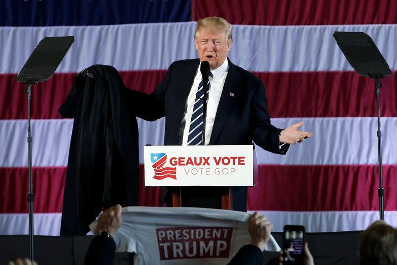 U.S. President-elect Donald Trump removes his coat as he speaks during a ''Thank You USA'' tour rally in Baton Rouge, Louisiana, U.S., December 9, 2016.  REUTERS/Mike Segar