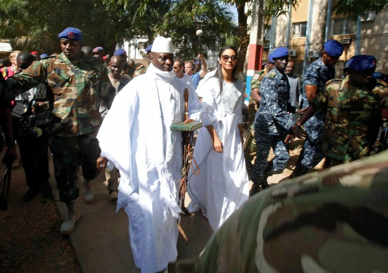 Gambian President Yahya Jammeh arrives at a polling station with his wife Zineb during the presidential election in Banjul, Gambia, December 1, 2016. REUTERS/Thierry Gouegnon