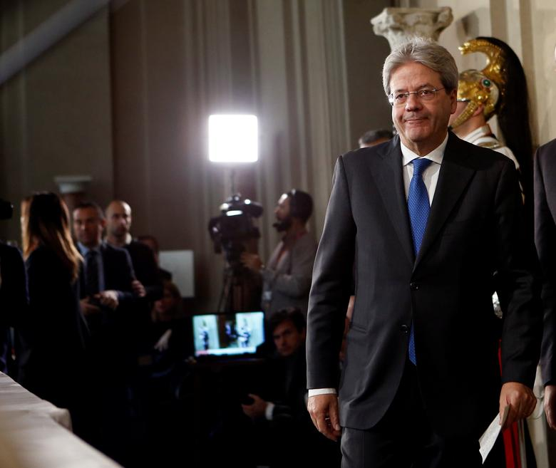 Italy's Foreign Minister Paolo Gentiloni leaves after receiving a mandate to try to form the country's new government at the Quirinal Palace in Rome, Italy December 11, 2016. REUTERS/Remo Casilli