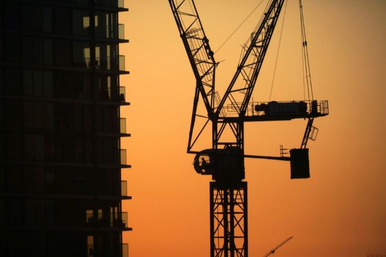 Cranes are seen on a construction site in London's financial district of Canary Wharf, Britain December 1, 2016.    REUTERS/Kevin Coombs