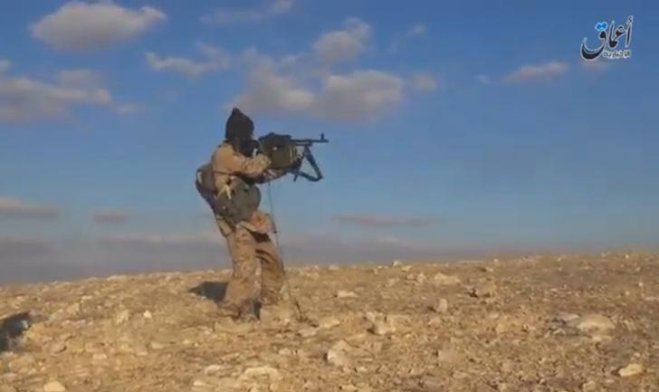 A still image taken from a video released by Islamic State-affiliated Amaq news agency, on December 11, 2016, purports to show an Islamic State fighter shooting near what is said to be Palmyra. Handout via REUTERS