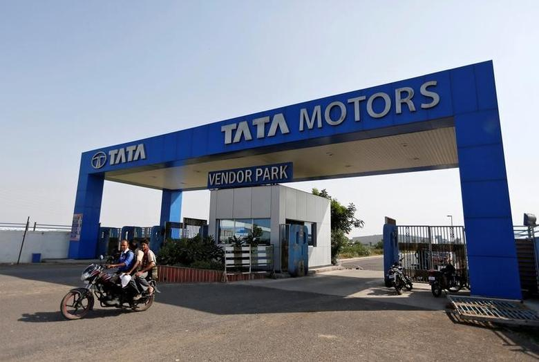 Men ride a motorbike as they come out of a past a Tata Motors car plant at Sanand in the western Indian state of Gujarat, India, October 27, 2016. REUTERS/Amit Dave
