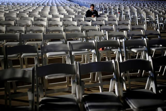 A student at the IAF academy sits within empty chairs waiting for the arrival of the first F-35s ordered by the Israeli air force to Israel at Nevatim in southern Israel December 12, 2016. REUTERS/Amir Cohen