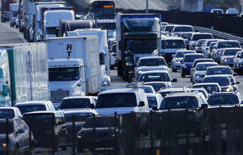 Automobile traffic backs-up as it travels  north from San Diego to Los Angeles along Interstate Highway 5 in California in this December 10, 2013 file photo. REUTERS/Mike Blake