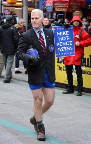 Glenn Pannell, known as ''Mike Hot-Pence'',  a look-alike for Vice President-elect Mike Pence, takes a collection for causes, including LGBT rights, in Times Square, New York, December 3, 2016. Courtesy Howard Sherman/Handout via REUTERS