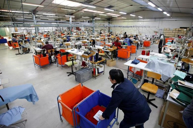 Employees work at the Royal Mer Bretagne factory, specializing in French manufactured knitted clothes, in La Regrippiere, western France, November 28, 2016. REUTERS/Stephane Mahe/File Photo