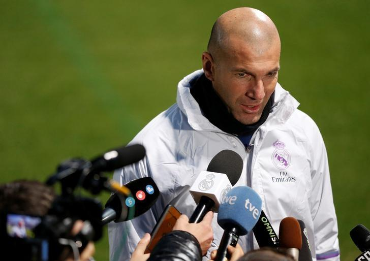 Football Soccer - Real Madrid training - FIFA Club World Cup - Yokohama, Japan - 12/12/16. Real Madrid's head coach Zinedine Zidane speaks to media before training session ahead of FIFA Club World Cup Semi-Final match against Club America. REUTERS/Issei Kato/Files