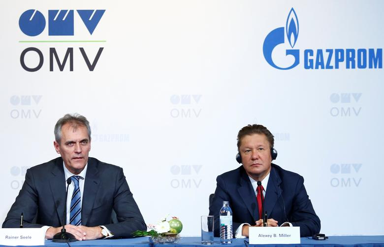 Chief Executive of Austrian oil and gas group OMV Rainer Seele and Gazprom chief executive Alexei Miller attend a news conference in Vienna, Austria, December 14, 2016.  REUTERS/Leonhard Foeger