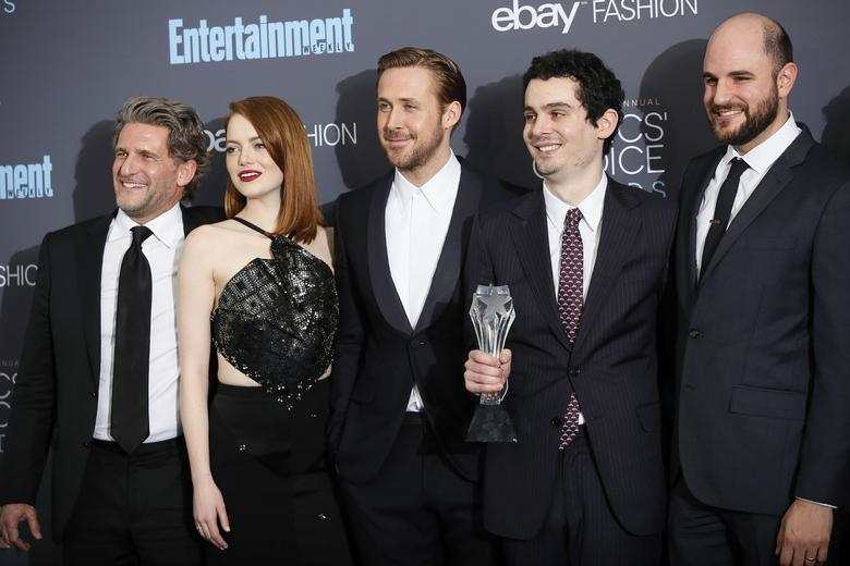 (L-R) Producer Gary Gilbert, actors Emma Stone and Ryan Gosling, director Damien Chazelle and producer Jordan Horowitz pose backstage with their award for Best Picture for ''La La Land'' during the 22nd Annual Critics' Choice Awards in Santa Monica, California, U.S., December 11, 2016.  REUTERS/Danny Moloshok/Files