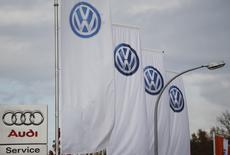 A logo of Audi is pictured next to flags with logos of VW at a car shop in Bad Honnef near Bonn, Germany, November 4, 2015. REUTERS/Wolfgang Rattay