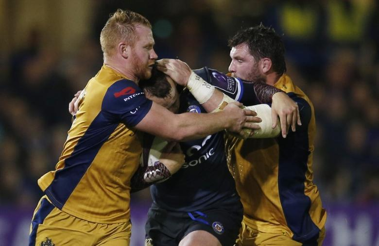 Britain Rugby Union - Bath Rugby v Bristol Rugby - European Rugby Challenge Cup Pool Four - Recreation Ground - 20/10/16Bath's Michael van Vuuren tackled by Bristol?s Will Hurrell and Bristol?s James Phillips Action Images via Reuters / Andrew CouldridgeLivepicEDITORIAL USE ONLY. - RTX2PRMX