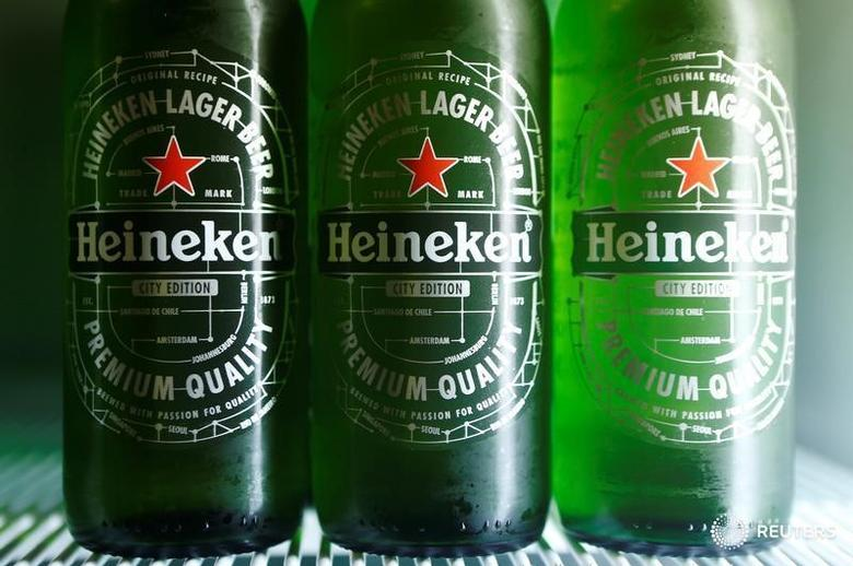 Botttles of Heineken lager beer are seen in a picture illustration inside a refrigerator in Vienna, Austria, October 18, 2016. REUTERS/Heinz-Peter Bader