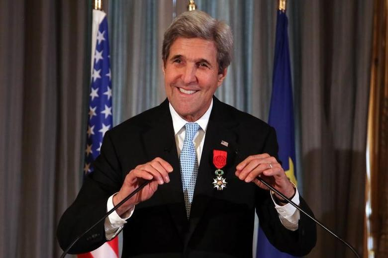 U.S. Secretary of State John Kerry smiles prior to delivering a speech after he was awarded the Legion d'Honneur medal, at the Quai d'Orsay, in Paris, France, December 10, 2016.   REUTERS/Thibault Camus/Pool
