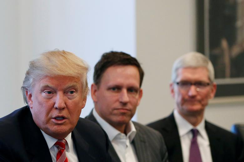 U.S. President-elect Donald Trump speaks as PayPal co-founder and Facebook board member Peter Thiel (C) and Apple Inc CEO Tim Cook look on during a meeting with technology leaders at Trump Tower in New York U.S., December 14, 2016. REUTERS/Shannon Stapleton
