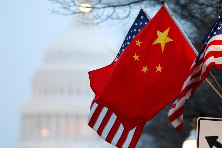The People's Republic of China flag and the U.S. Stars and Stripes fly along Pennsylvania Avenue near the U.S. Capitol during Chinese President Hu Jintao's state visit in Washington, DC, U.S. on January 18, 2011. REUTERS/Hyungwon Kang/File Photo