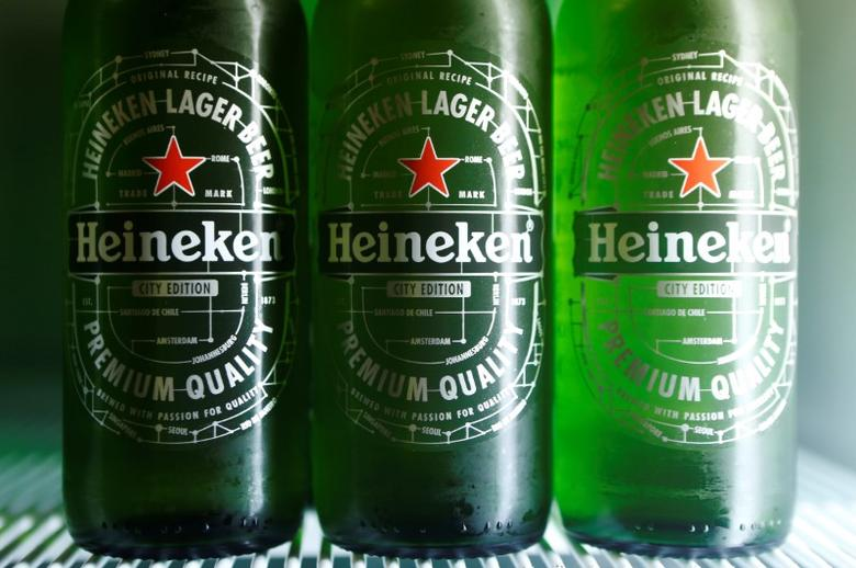 Botttles of Heineken lager beer are seen in a picture illustration inside a refrigerator in Vienna, Austria, October 18, 2016. REUTERS/Heinz-Peter Bader