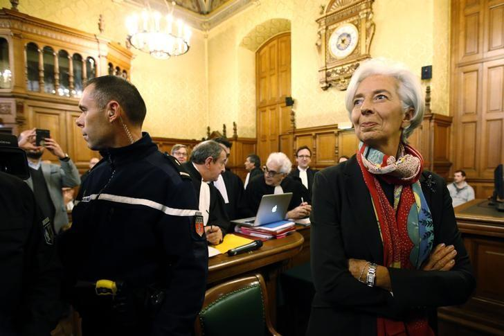 Managing Director of the International Monetary Fund (IMF) Christine Lagarde reacts before the start of her trial about a state payout in 2008 to a French businessman, at the courts in Paris, France, December 12, 2016.   REUTERS/Charles Platiau