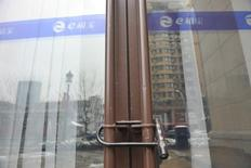 A closed branch office of Ezubao, once China's biggest P2P lending platform, is seen in Hangzhou, Zhejiang province, China, February 1, 2016. REUTERS/Stringer