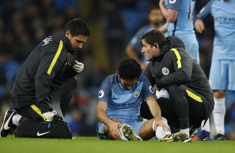 Manchester City's Ilkay Gundogan receives treatment after sustaining a injury. Manchester City v Watford - Premier League - Etihad Stadium - 14/12/16.  Reuters / Phil Noble Livepic