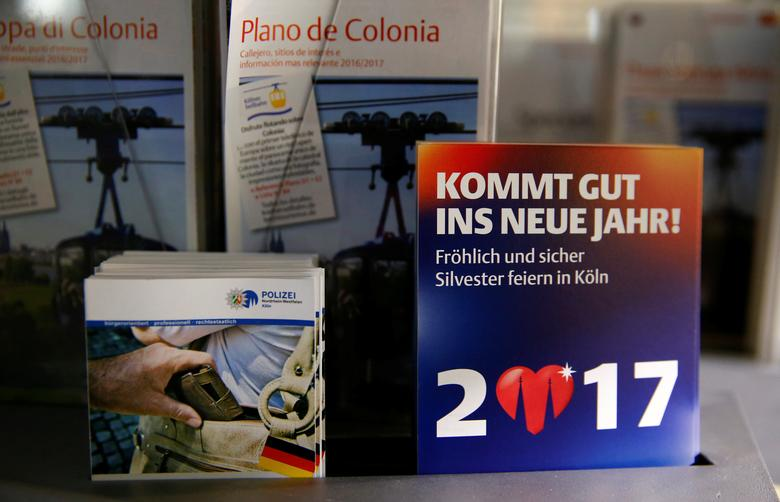 Brochures of the federal police of North Rhine-Westphalia (NRW) are displayed near Cologne's Cathedral in Cologne, Germany, December 16, 2016. REUTERS/Wolfgang Rattay