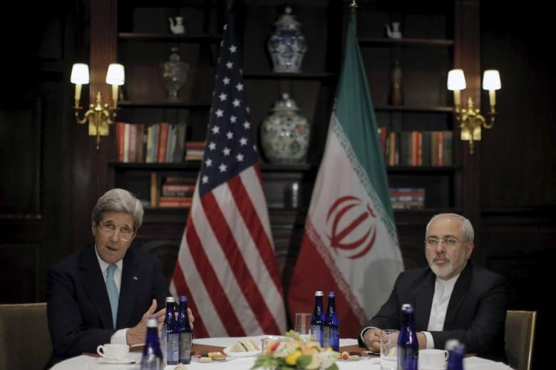 U.S. Secretary of State John Kerry (L) meets with Iran