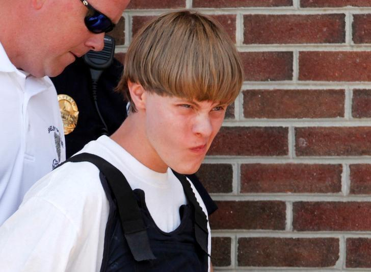 Police lead suspected shooter Dylann Roof, 21, into the courthouse in Shelby, North Carolina, June 18, 2015.      REUTERS/Jason Miczek/File Photo
