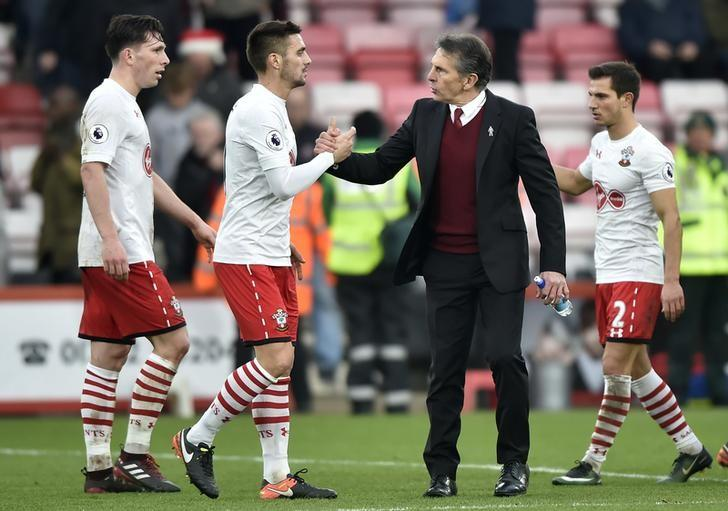 Britain Football Soccer - AFC Bournemouth v Southampton - Premier League - Vitality Stadium - 18/12/16 Southampton's Sofiane Boufal and manager Claude Puel celebrate after the game  Reuters / Hannah McKay Livepic