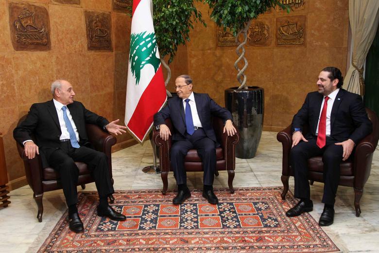 Lebanon's President Michel Aoun (C) meets with Prime minister-designate Saad al-Hariri (R) and Parliament Speaker Nabih Berri at the presidential palace in Baabda, Lebanon December 18, 2016. Dalati Nohra/Handout via Reuters