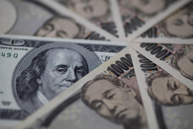 A U.S. one-hundred dollar bill (C) and Japanese 10,000 yen notes are spread in Tokyo, in this February 28, 2013 picture illustration.  REUTERS/Shohei Miyano/File Photo